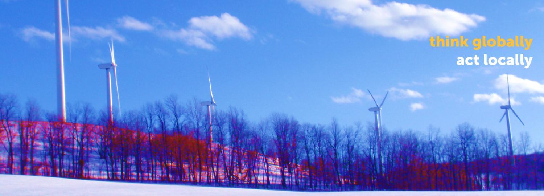 wind turbines on a snowy hillside