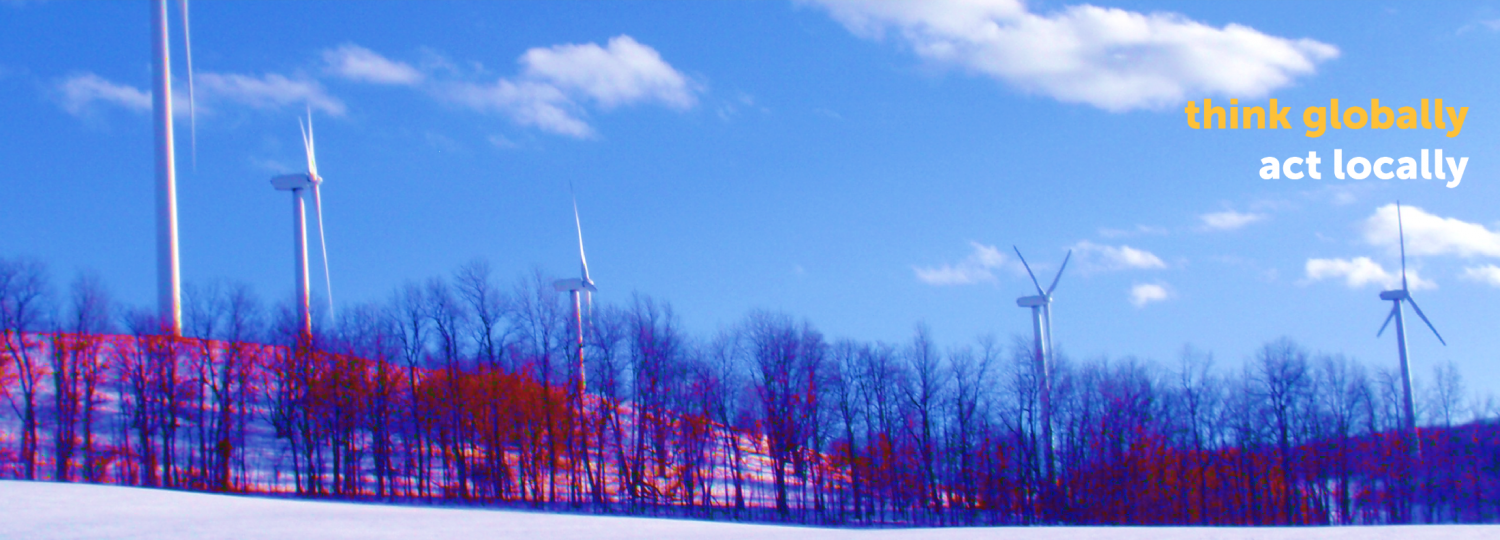 wind turbines on a snowy hillside